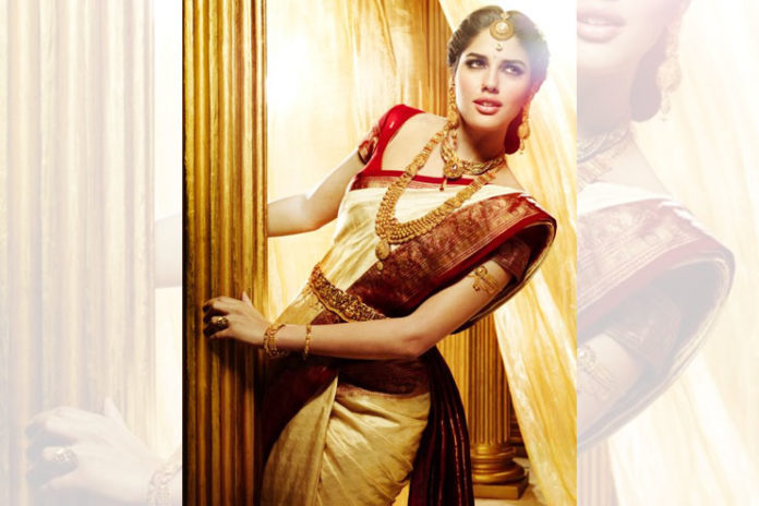 Gold saree with red blouse