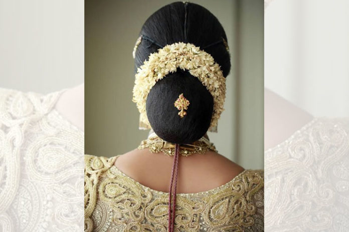 Low bun with simple jasmine gajra