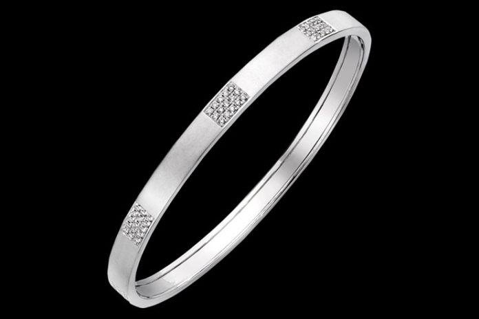 Diamond engraved platinum bangle