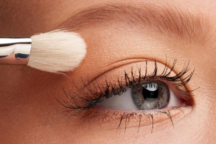 Putting on eyeshadow