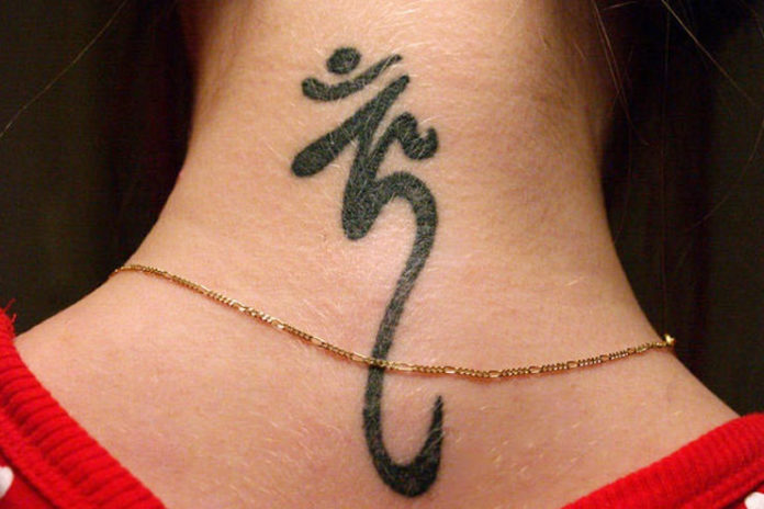 Om neck tattoo