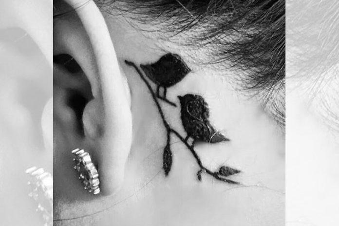 Small love birds on back of an ear