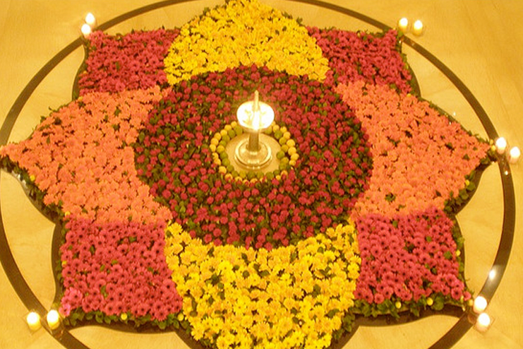 Full flowers in a rangoli and diyas