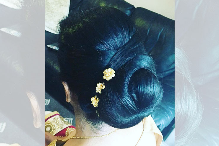 Criss criss accentred bun with flowers